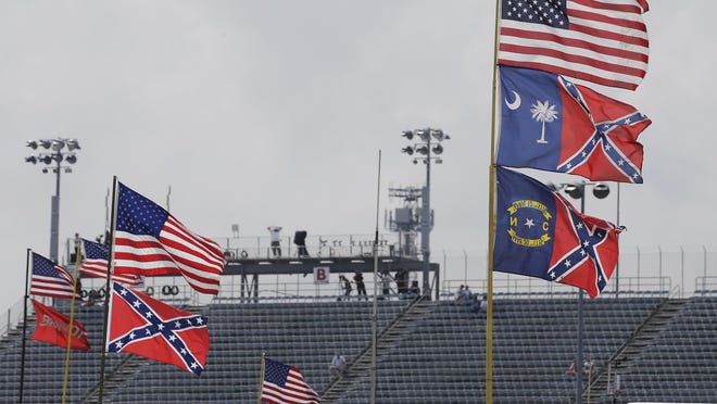 Confederate themed flags fly in the infield before a NASCAR Xfinity auto race at Darlington Raceway in Darlington, S.C., Saturday, Sept. 5, 2015.