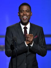 Chris Rock speaks onstage during the BET AWARDS at Nokia Theatre in 2014 in Los Angeles, California.