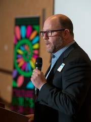 "David Bear speaks during the ""State of the Arts"" luncheon"