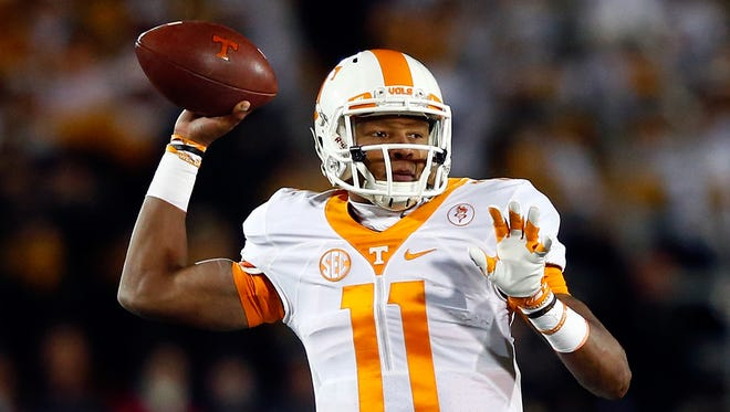 Quarterback Joshua Dobbs of the Tennessee Volunteers passes during the game against the Missouri Tigers at Faurot Field/Memorial Stadium on November 21, 2015 in Columbia, Missouri.