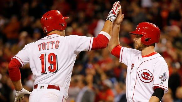 Cincinnati Reds first baseman Joey Votto is congratulated