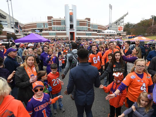 Clemson players and fans take part in Tiger Walk before