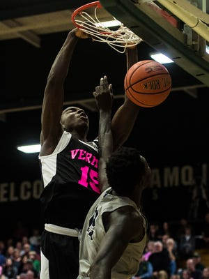 UVM's #15 Ra Kpedi slum dunks over UNH's #12 Iba Camara during their men's basketball game Thursday night, Feb. 15, 2018, at Patrick Gym in Burlington.