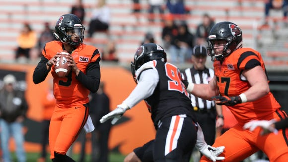 Oregon State's Marcus McMaryion looks for an opening during the Beavers' spring game on Saturday, March 18, 2017, at Reser Stadium in Corvallis.