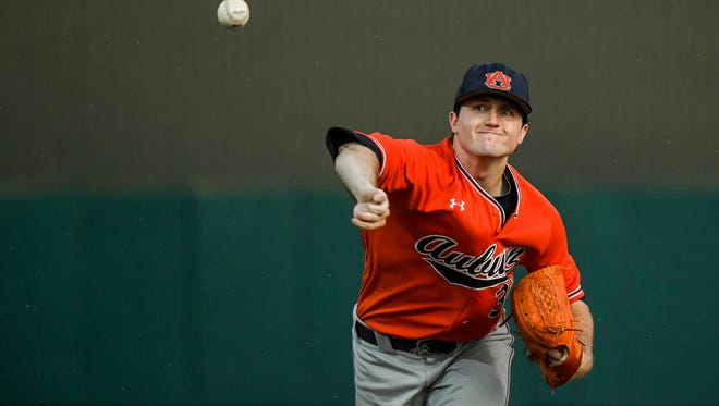 Auburn pitcher Casey Mize gets his 10th victory of the season in a win over Army in the NCAA Raleigh Regional on Saturday.