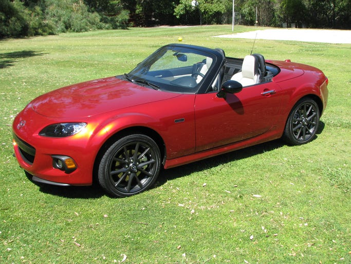 Mazda's MX-5 Miata 25th Anniversary Edition, previously seen at the New York Auto Show, goes outdoors in Malibu, Calif., for an auto journalists' gathering