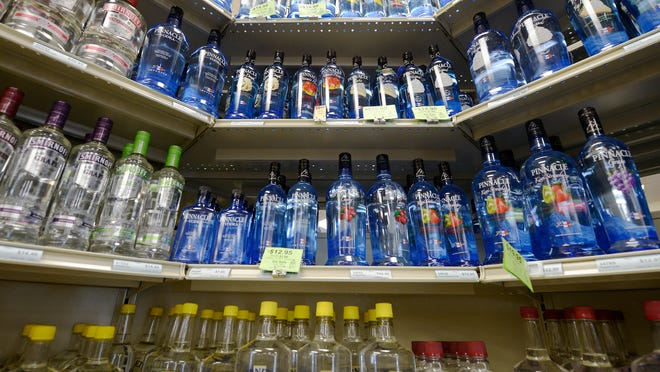 ORG XMIT: VAHAR102 Liquor bottles line the shelves at the Alcohol Beverage Control store in the Skyline Village Shopping Center in Harrisonburg, Va. on Friday, June 29, 2012. A new law that takes effect Sunday, July 1, allows Virginia ABC stores to open in the afternoon on Sundays. (AP Photo/The Daily News-Record, Justin Falls)