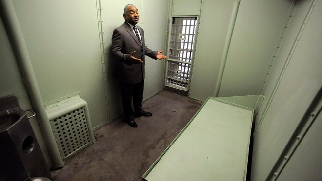 Jefferson County Sheriff Mark Pettway speaks in a cell at the old county jail in Birmingham, Ala.