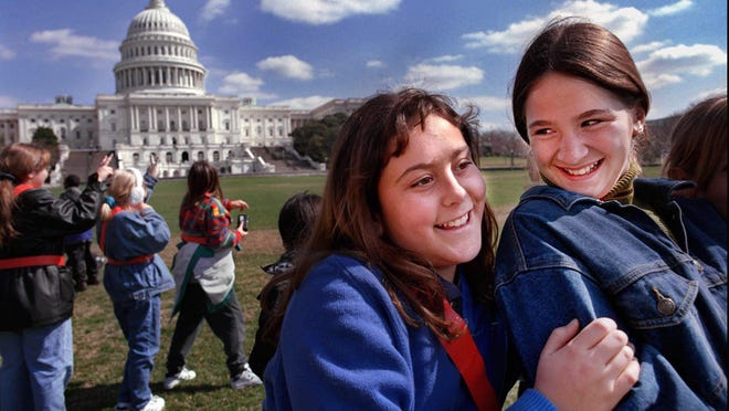 Two Palm Beach County students visit the lawn of the United States Capitol during a safety patrol trip to Washington D.C. in 1998.