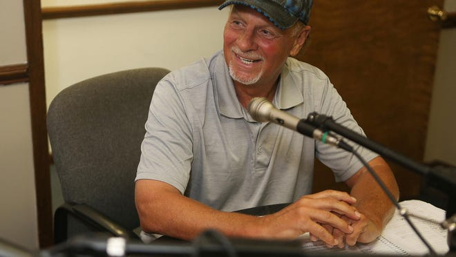 Former Southwest High football coach Phil Padgett speaks in the microphone during a recent broadcast of his radio show on Freedom 97.1 WSME.