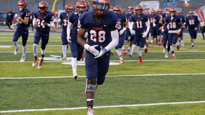 The Ellet High School football team takes to the field on Oct. 4, 2019. This season, all Akron Public Schools sports practices and games and all face-to-face extracurricular activities will grind to a halt following action from the school board Monday night.