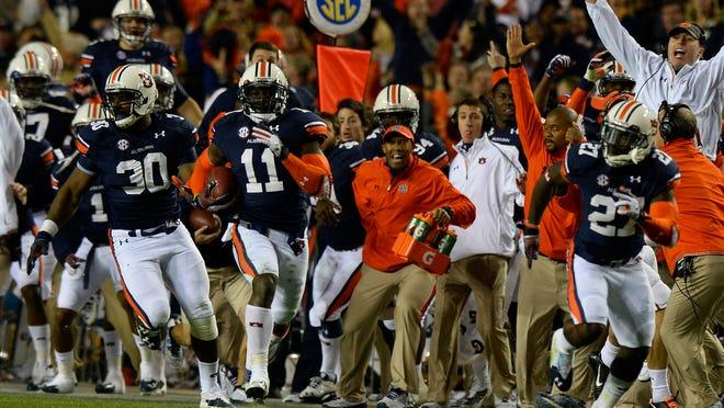 Auburn's Chris Davis returns a missed field goal for the winning touchdown against Alabama on Nov. 30 in Auburn.