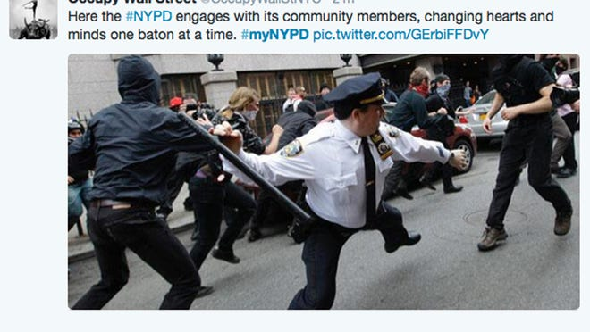 A Twitter post shows an officer wielding a baton during an Occupy Wall Street action in New York.