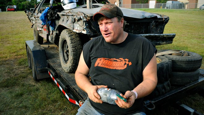 Andy Hanson, Clearwater, talks with the other drivers in the pit area before the start of the demolition derby July 20 at the Sherburne County Fair in Elk River.