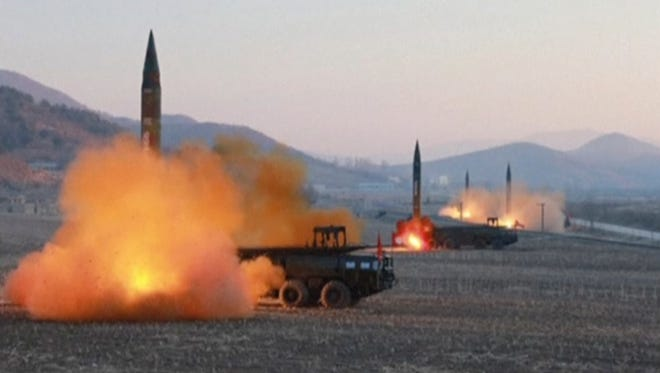 In this file image made from video released by KRT on March 7, 2017, North Korea launches four missiles in an undisclosed location.