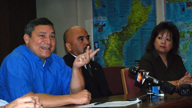 In this June 6, 2012, file photo, Gov. Eddie Calvo speaks at a signing ceremony for documents to finalize the borrowing of $108 from the bond market. Of the money, $60 million went toward 2011 income tax refunds.