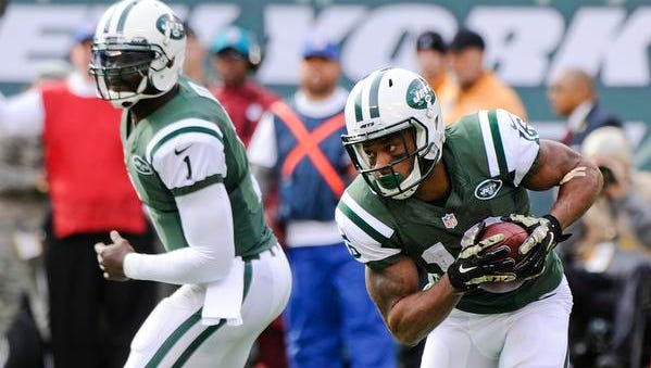 Jets wide receiver Percy Harvin, right, runs with the ball as teammate Michael Vick watches during the first half of the game against the Pittsburgh Steelers on Nov. 10 in East Rutherford, New Jersey.