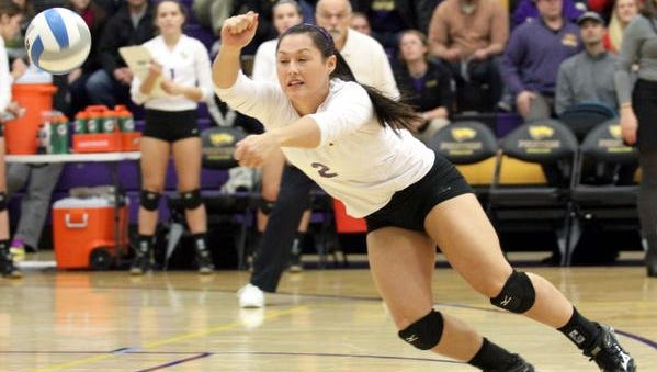 CW 1109 UWSPVolleyball_1.jpg University of Wisconsin Stevens Point's Bri Piepenbrok dives for a spike against UW-Whitewater Saturday in the Berg Gymnasium in Stevens Point. Photo by Thomas Kujawski/FOR CENTRAL WISCONSIN SUNDAY