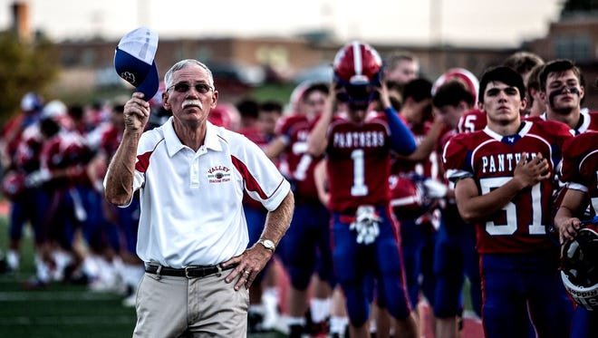 Licking Valley coach Randy Baughman removes his cap for the national anthem prior to his 300th win last Friday, a 57-20 victory against Northridge in Randy Baughman Stadium.