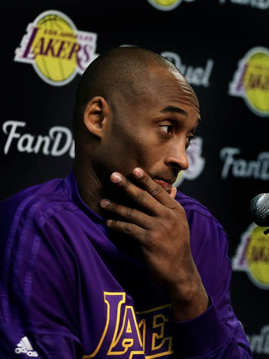 Los Angeles Lakers' Kobe Bryant listens to a question from a reporter during a media conference prior to an NBA basketball game against the Golden State Warriors, Thursday, Jan. 14, 2016, in Oakland, Calif. (AP Photo/Ben Margot)