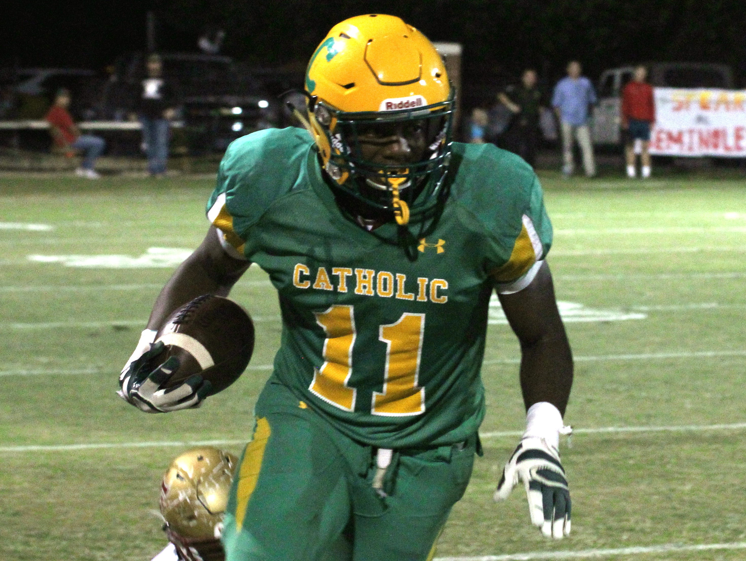 Catholic's Kerrick Teamer returns a punt in the first half.