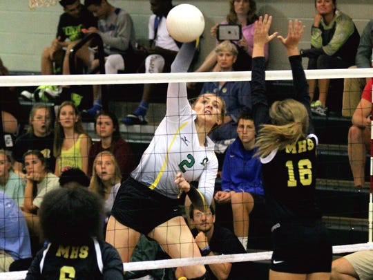 Catholic's Ellen Floyd hits a kill shot in this file