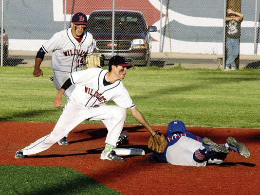 Bill Armendaiz - Headlight Photos   Second-baseman Jacob Quarrell triggered this double play with the unassisted put-out at second base while short stop Danre Urrea back's up the play. Deming swept a pair from the visiting Las Cruces High Bulldawgs Friday, 6-4 and 8-2.