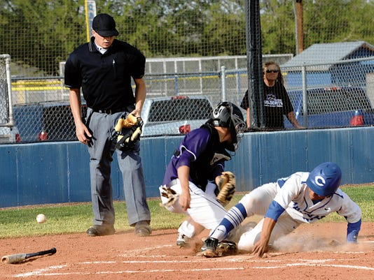 Matt Hollinshead — Current-Argus Junior catcher Eric Hernandez scores Carlsbad's first run against Clovis senior catcher Derek Kuykendall in the bottom of the third inning of game one Friday at Cavemen Field.