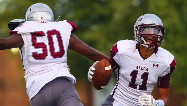Alcoa's Tykee Ogle-Kellogg, right