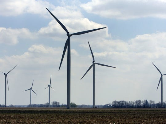 A file photo of wind turbines at the Harvest Wind Farm in Oliver Township, Mich.