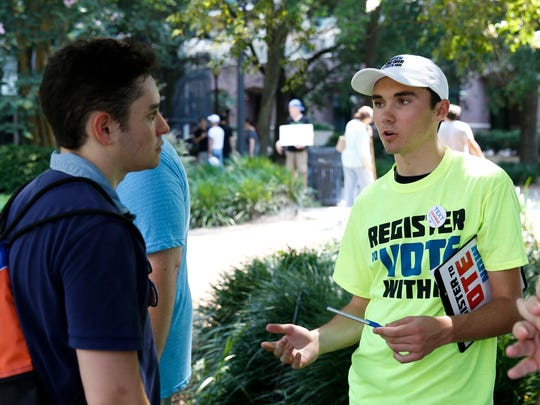 Marjory Stoneman Douglas student and vocal gun control activist David Hogg speaks to attendees of the Road to Change Rally held in Kleman Plaza on Saturday.