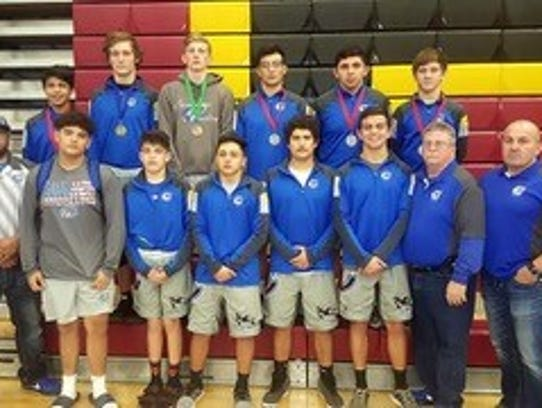 Coach Salcido and the varsity squad and their medals.
