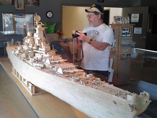 A Dubuque visitor takes a close-up of details of the