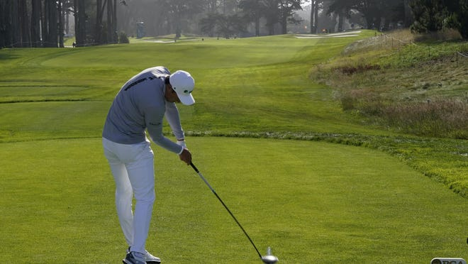 Li Haotong of China hits his tee shot on the 10th hole during the second round of the PGA Championship at TPC Harding Park on Friday in San Francisco.