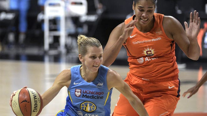 Chicago Sky guard Allie Quigley drives to the basket in front of Connecticut Sun center Brionna Jones on Tuesday in Bradenton, Fla.