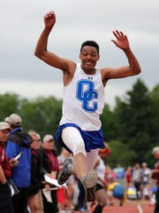 James Carter of Oak Creek wins the boys Division 1 triple jump with a mark of 49 feet 2 inches on Saturday.
