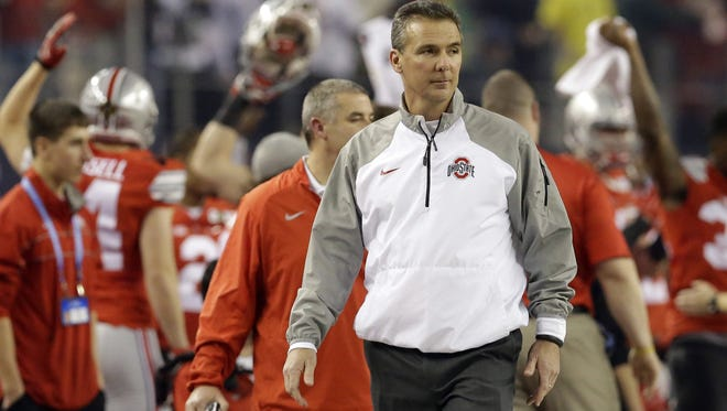 Ohio State head coach Urban Meyer watches before the NCAA college football playoff championship game against Oregon Monday, Jan. 12, 2015, in Arlington, Texas.