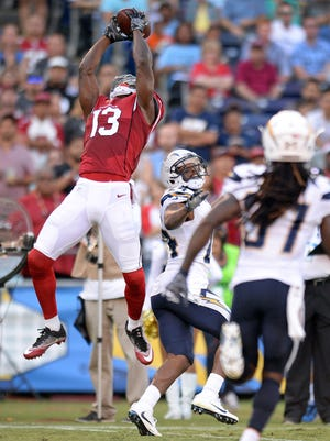 Aug 19, 2016; San Diego, CA, USA;  Arizona Cardinals wide receiver Jaron Brown catches a pass as San Diego Chargers cornerback Brandon Flowers defends during the first quarter at Qualcomm Stadium.