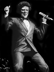 Tom Jones performs at the Grand Ole Opry House in Tennessee on Sept. 4, 1985.