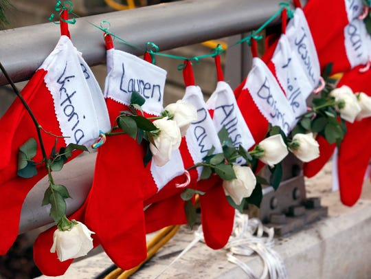 Christmas stockings with the names of shooting victims