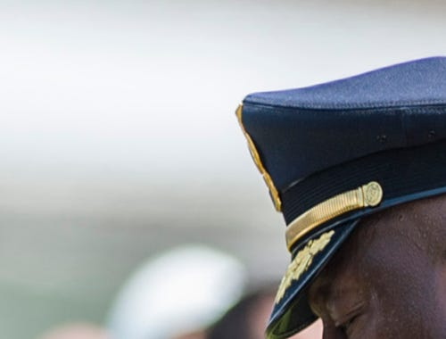 Shreveport Police Chief Willie Shaw bows his head in
