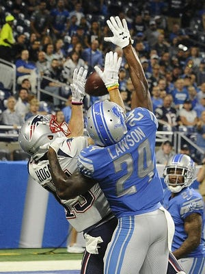 The Patriots' Chris Hogan makes a touchdown reception with the Lions' Kevin Lawson defending in the first quarter.