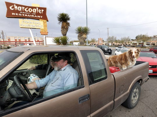 Mike and Diane Waldo, along with their dogs. waited in line at Charcoaler Drive-In Restaurant Friday. The popular West Side burger joint is closing Jan. 31.