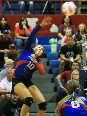 Las Cruces High School left side hitter Alyssa Barrera (10) spikes the ball over against El Paso Franklin High School on Tuesday at LCHS.