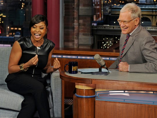 """In this photo provided by CBS, actress Taraji P. Henson from the CBS drama series """"Person of Interest,"""" joins host David Letterman on the set of the ?Late Show with David Letterman."""