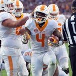 Tennessee running back John Kelly (4) celebrates after scoring a touchdown in the second half of the game against Texas A&M on Saturday, October 8, 2016. Tennessee loses to Texas A&M, 38-45. (SAUL YOUNG/NEWS SENTINEL)