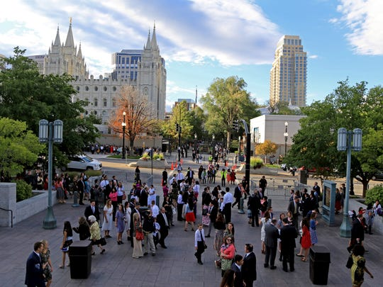 Members of The Church of Jesus Christ of Latter-day Saints walk from Temple Square to the Confereence Center in Salt Lake City for the church's Semiannual General Conference on Sunday.