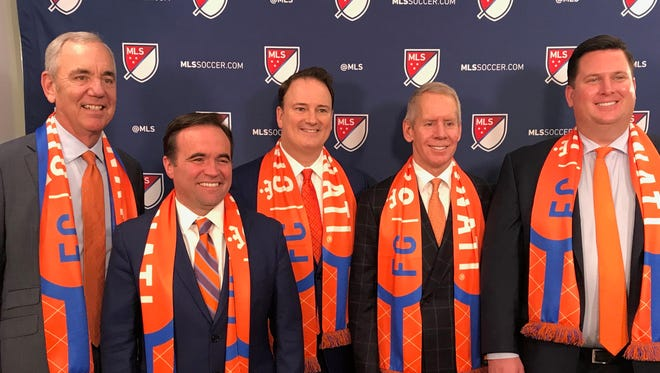A Futbol Club Cincinnati delegation poses for a group photo opportunity following a media session and a presentation to some of the top brass in Major League Soccer at the league's New York City headquarters