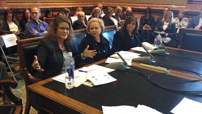 Kimberly Foltz, left, Iowa chief executive officer for UnitedHealthcare, tells legislators about the state's switch to privately managed Medicaid during a Dec. 13, 2016, hearing at the Statehouse. Seated next to her are Cynthia MacDonald, Amerigroup's Iowa president, center, and Cheryl Harding, AmeriHealth Caritas' Iowa president.
