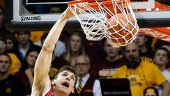 Wisconsin's Ethan Happ dunks against Minnesota.
